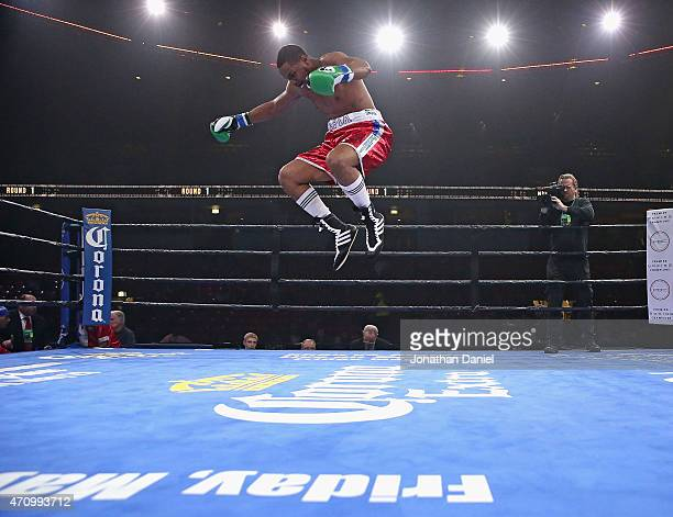 Keith Tapia leaps in celebration after a first round TKO against Jason Smith during a cruiserweight fight at the UIC Pavilion on April 24, 2015 in...