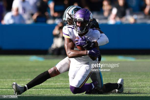 Keith Taylor Jr. #28 of the Carolina Panthers tackles K.J. Osborn of the Minnesota Vikings during overtime in a game at Bank of America Stadium on...