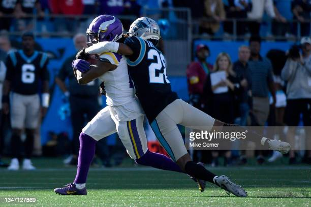 Keith Taylor Jr. #28 of the Carolina Panthers tackles K.J. Osborn of the Minnesota Vikings during the fourth quarter at Bank of America Stadium on...