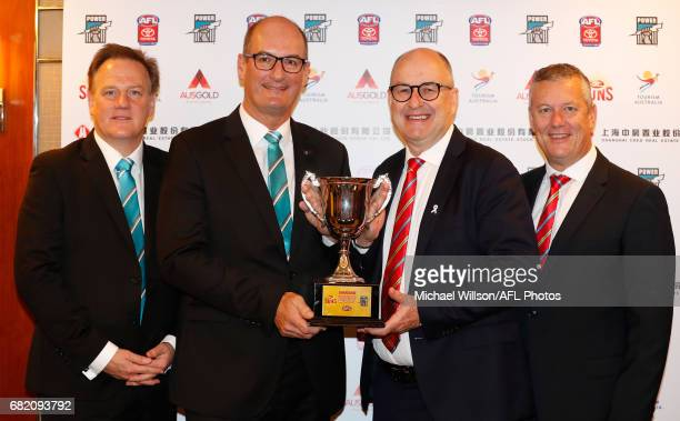 Keith Thomas CEO of the Power David Koch Chairman of the Power Tony Cochrane Chairman of the Suns and Mark Evans CEO of the Suns pose for a...