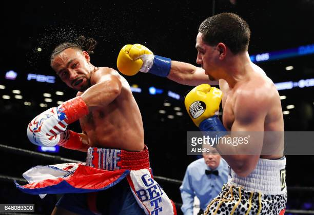 Keith Thurman and Danny Garcia exchange punches during their WBA/WBC Welterweight unification Championship bout at the Barclays Center in Brooklyn...