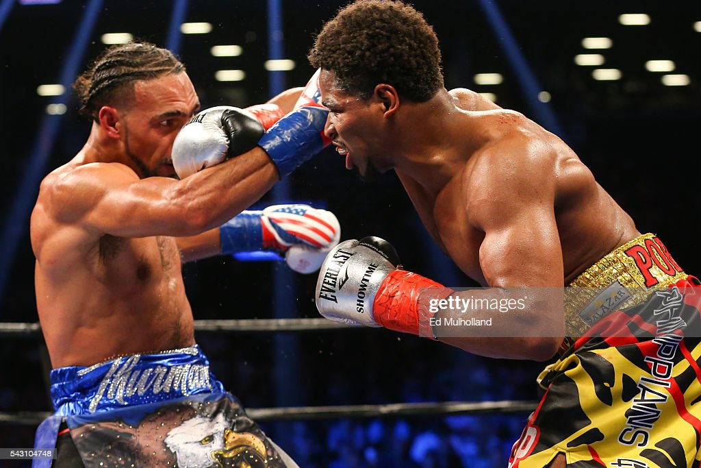 Keith Thurman (left) and Shawn Porter (right) trade punches during their 12 round WBA welterweight championship bout at the Barclays Center on June 25, 2016 in the Brooklyn borough of New York City.