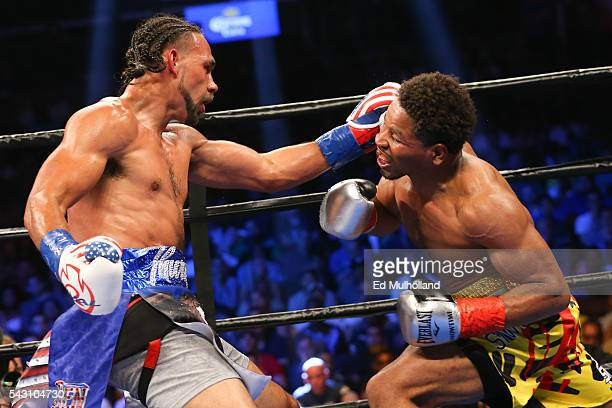 Keith Thurman lands a left hand to the head of Shawn Porter during their 12 round WBA welterweight championship bout at the Barclays Center on June...