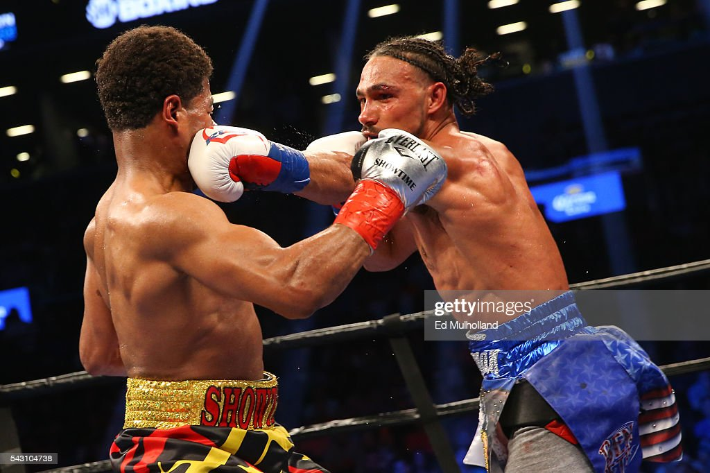 Keith Thurman (right) lands a left hand to the head of Shawn Porter (left) during their 12 round WBA welterweight championship bout at the Barclays Center on June 25, 2016 in the Brooklyn borough of New York City.