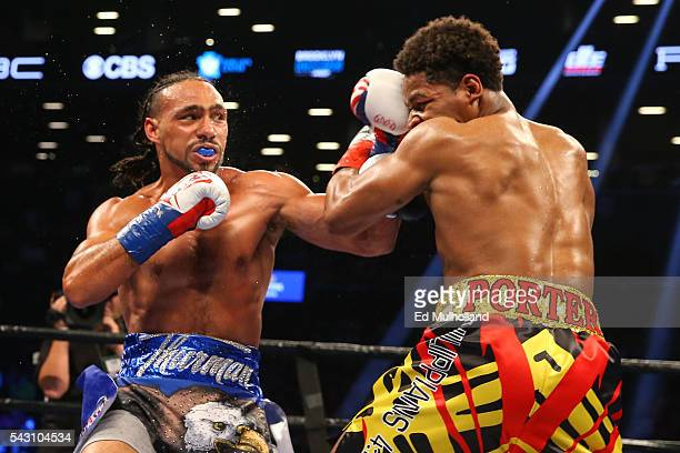 Keith Thurman lands a left hook to the head of Shawn Porter during their 12 round WBA welterweight championship bout at the Barclays Center on June...