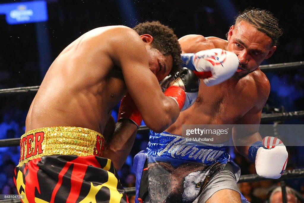 Keith Thurman (right) lands a right hand to the head of Shawn Porter (left) during their 12 round WBA welterweight championship bout at the Barclays Center on June 25, 2016 in the Brooklyn borough of New York City.