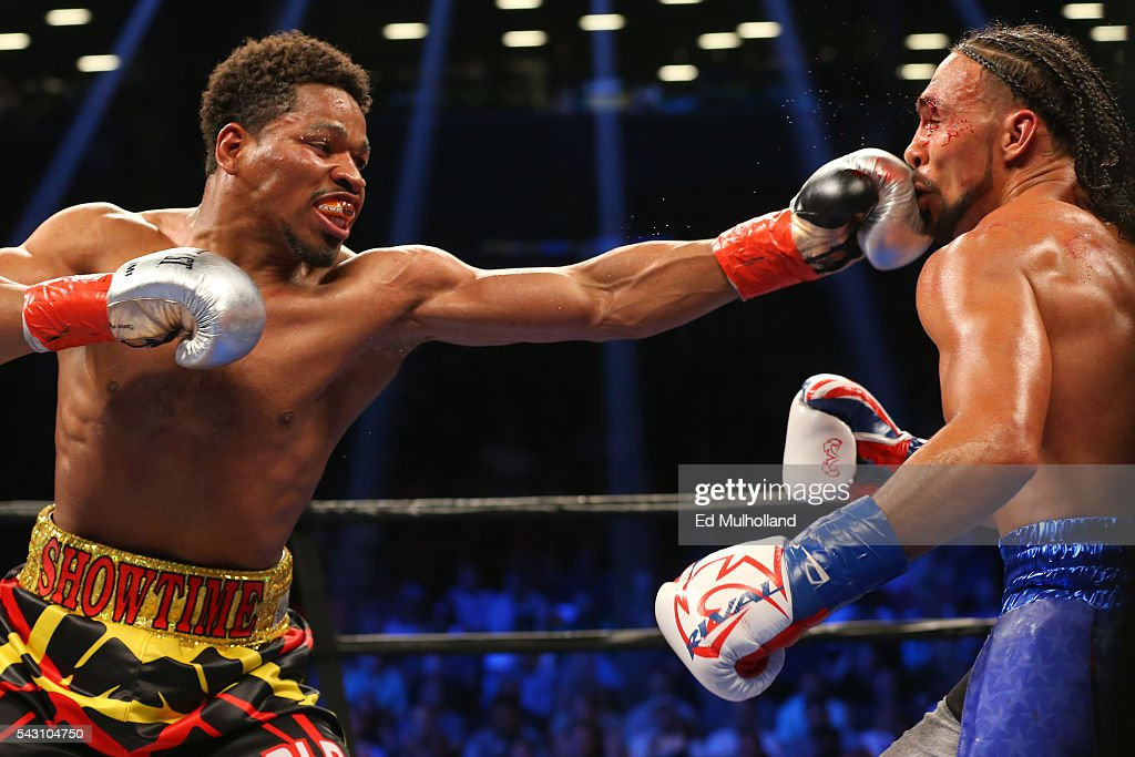 Keith Thurman (right) takes a left hand from Shawn Porter (left) during their 12 round WBA welterweight championship bout at the Barclays Center on June 25, 2016 in the Brooklyn borough of New York City.