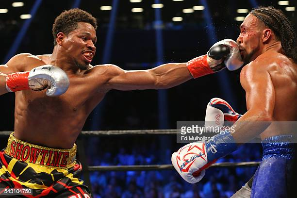 Keith Thurman takes a left hand from Shawn Porter during their 12 round WBA welterweight championship bout at the Barclays Center on June 25 2016 in...