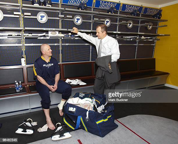 Keith Tkachuk of the St Louis Blues talks with Blues Assistant General Manager and former teammate Al MacInnis after his last home game of his career...