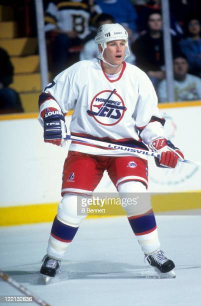 Keith Tkachuk of the Winnipeg Jets skates on the ice during an NHL game against the Boston Bruins on December 31 1995 at the Winnipeg Arena in...