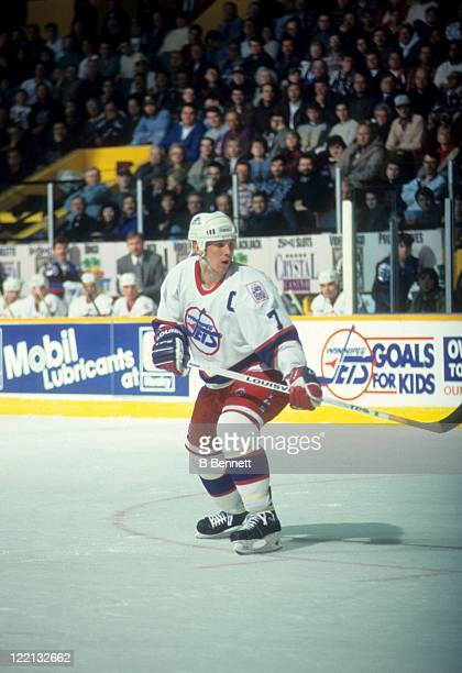 Keith Tkachuk of the Winnipeg Jets skates on the ice during an NHL game in February 1995 at the Winnipeg Arena in Winnipeg Manitoba Canada