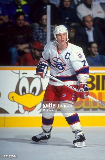 Keith Tkachuk of the Winnipeg Jets skates on the ice during an NHL game in December 1993 at the Winnipeg Arena in Winnipeg Manitoba Canada