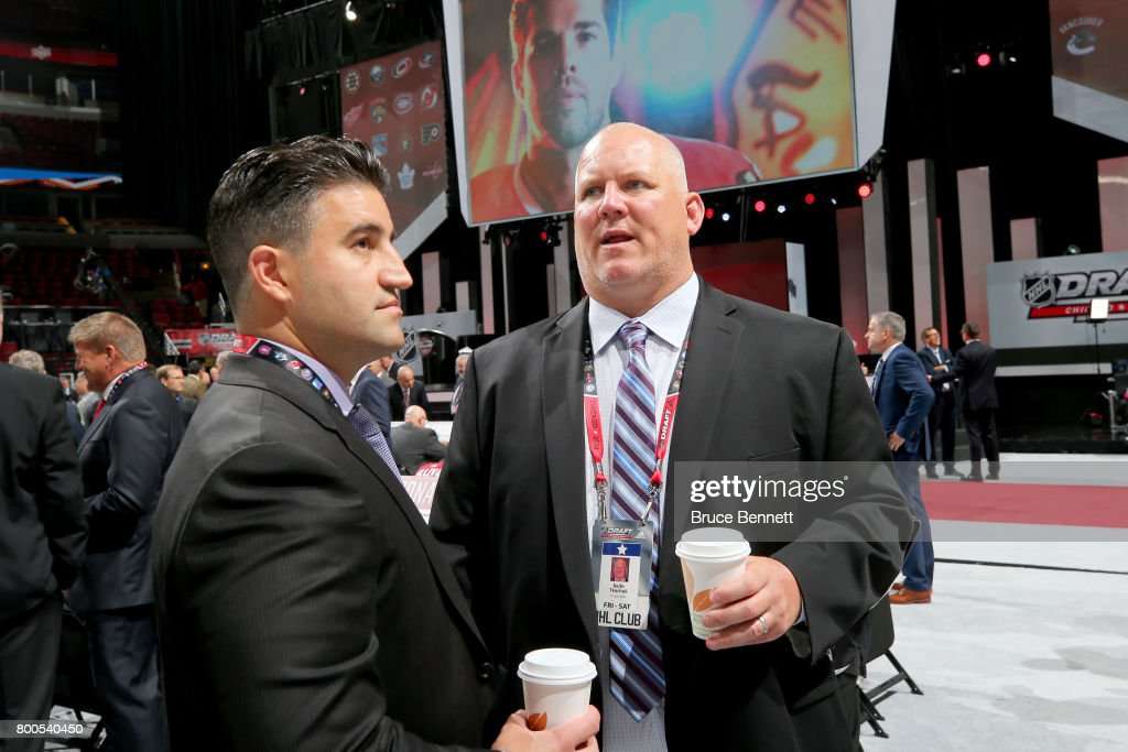 Keith Tkachuk (R) talks prior to the 2017 NHL Draft at the United Center on June 24, 2017 in Chicago, Illinois.