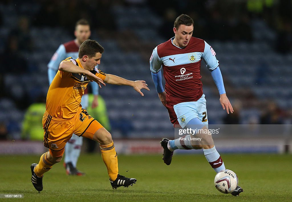 Keith Treacy of Burnley runs at Alex Bruce of Hull City during the npower Championship match between Burnley and Hull City at Turf Moor on March 11, 2013 in Burnley, England.