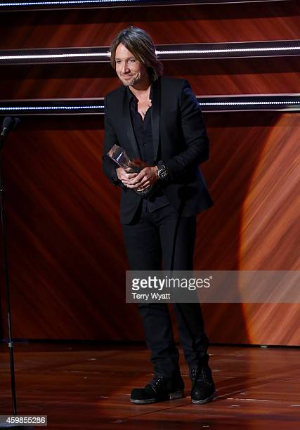 Keith Urban accepts the Artist of the Year Award at the 2014 CMT Artists Of The Year at the Schermerhorn Symphony Center on December 2 2014 in...