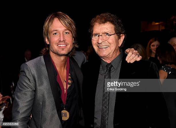 Keith Urban and BMI Icon Award Winner Mac Davis pose during the 63rd annual BMI Country awards on November 3 2015 in Nashville Tennessee