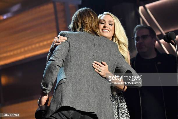 Keith Urban and Carrie Underwood accept the Vocal Event of the Year award for 'The Fighter' onstage during the 53rd Academy of Country Music Awards...