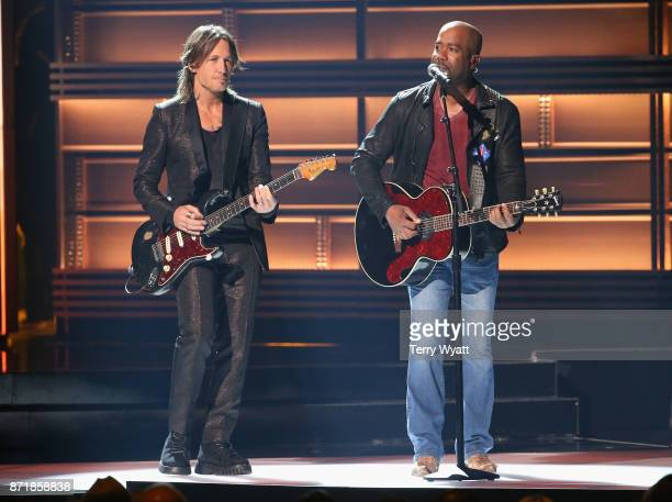 Keith Urban and Darius Rucker perform onstage at the 51st annual CMA Awards at the Bridgestone Arena on November 8 2017 in Nashville Tennessee