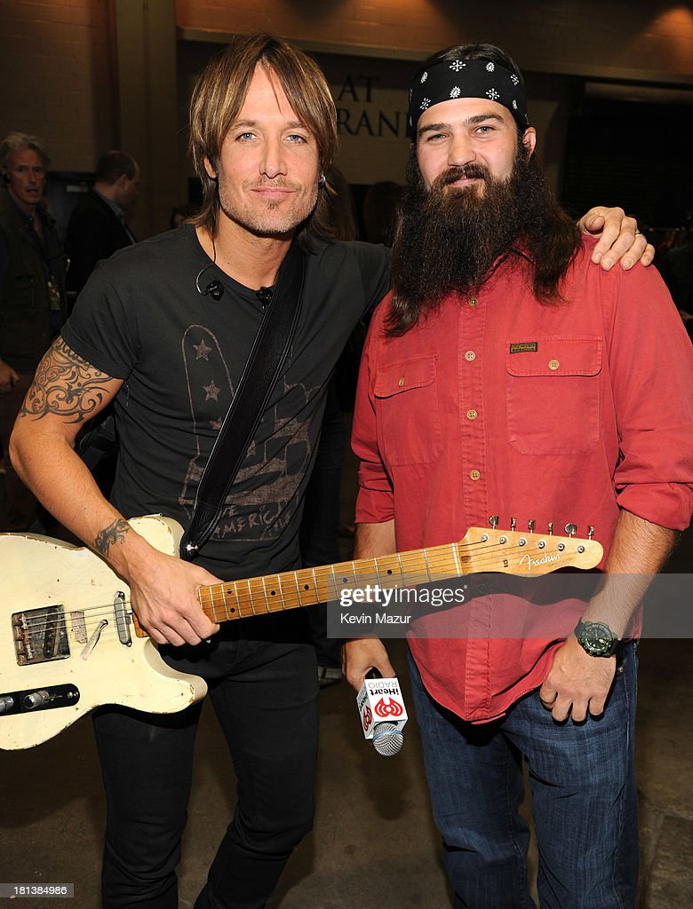 Keith Urban and Jep Robertson attend the iHeartRadio Music Festival at the MGM Grand Garden Arena on September 20, 2013 in Las Vegas, Nevada.