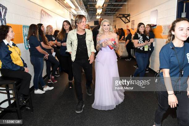 Keith Urban and Julia Michaels walk backstage during the 2019 CMT Music Awards Backstage Audience at Bridgestone Arena on June 05 2019 in Nashville...