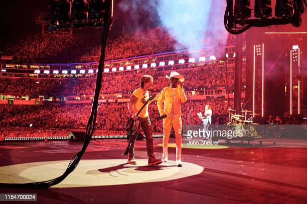 Keith Urban and Lil Nas X perform on stage during day 3 of the 2019 CMA Music Festival on June 08, 2019 in Nashville, Tennessee.