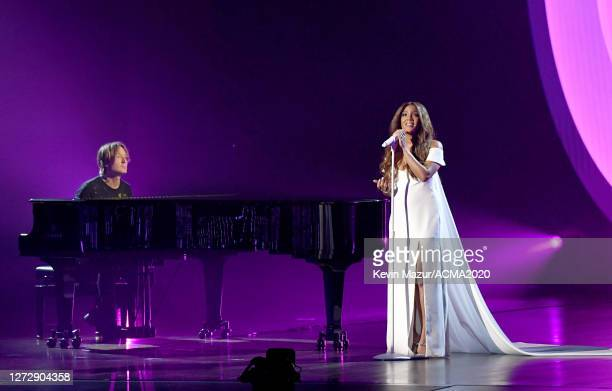 Keith Urban and Mickey Guyton perform onstage during the 55th Academy of Country Music Awards at the Grand Ole Opry on September 16 2020 in Nashville...