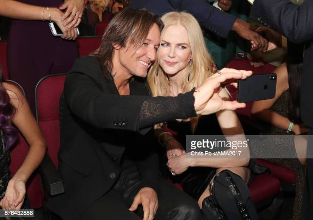 Keith Urban and Nicole Kidman take a selfie during the 2017 American Music Awards at Microsoft Theater on November 19 2017 in Los Angeles California