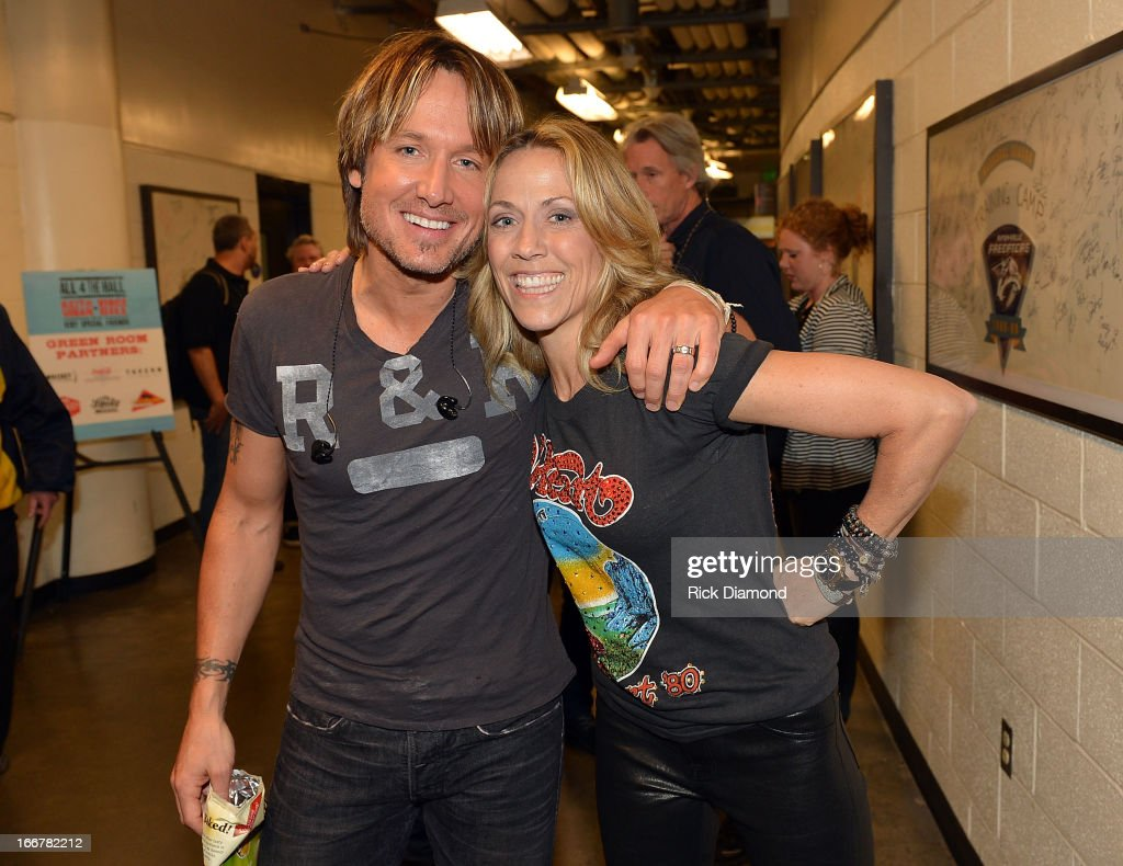 Keith Urban and Sheryl Crow backstage during Keith Urban's Fourth annual We're All For The Hall benefit concert at Bridgestone Arena on April 16, 2013 in Nashville, Tennessee.