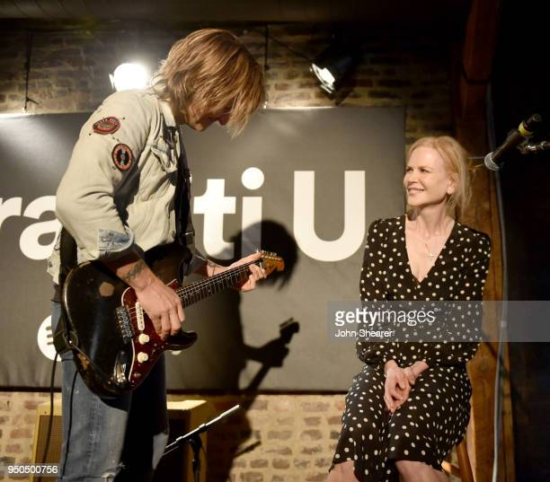 Keith Urban and wife Nicole Kidman perform onstage for a spotify fans first event at Houston Station on April 23 2018 in Nashville Tennessee