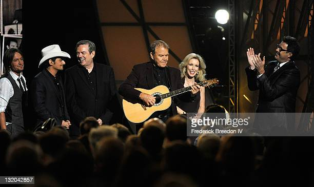 Keith Urban Brad Paisley Jimmy Webb Glen Campbell Kim Campbell and Vince Gill receive a standing ovation at the 45th annual CMA Awards at the...