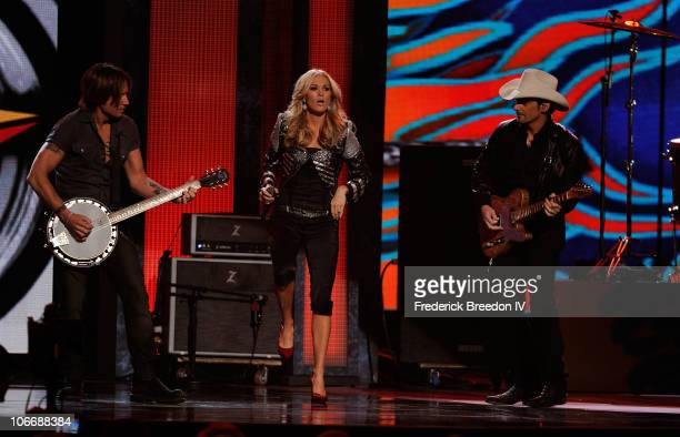 Keith Urban Carrie Underwood and Brad Paisley perform onstage at the 44th Annual CMA Awards at the Bridgestone Arena on November 10 2010 in Nashville...