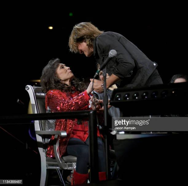 Keith Urban greets Loretta Lynn during Loretta Lynn An AllStar Birthday Celebration Concert at Bridgestone Arena on April 1 2019 in Nashville...