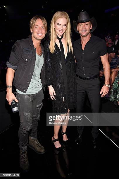 Keith Urban Nicole Kidman and Tim McGraw attend the 2016 CMT Music awards at the Bridgestone Arena on June 8 2016 in Nashville Tennessee