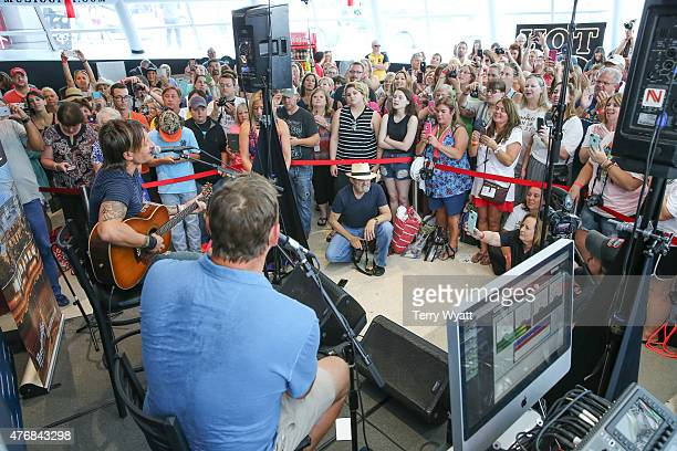 Keith Urban performs live on SiriusXM's The Highway Channel with host Storme Warren at the SiriusXM Studios in Nashville on June 11 2015 in Nashville...