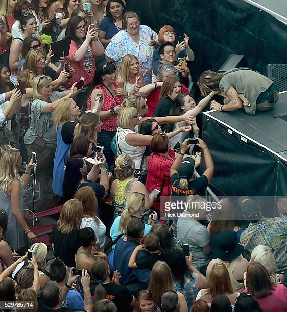Keith Urban performs older and brand new music from his new album 'Ripcord' during his Free Concert For Fans outside Bridgestone Arena on May 9 2016...