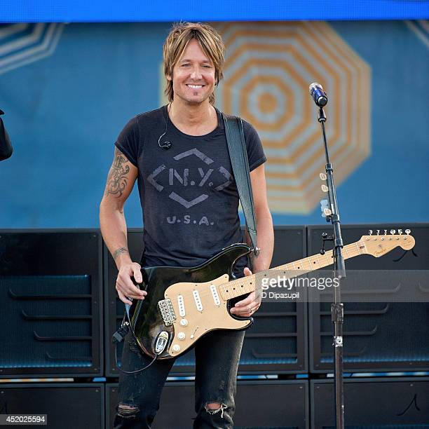 Keith Urban performs on ABC's 'Good Morning America' at Rumsey Playfield Central Park on July 11 2014 in New York City