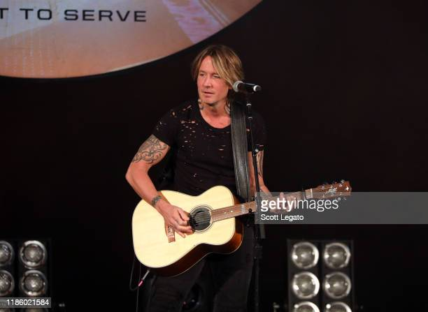 "Keith Urban performs on stage during ""Stars and Strings Presented by RAM Trucks Built to Serve"" a RADIOCOM Event at the Fox Theatre on November 06..."