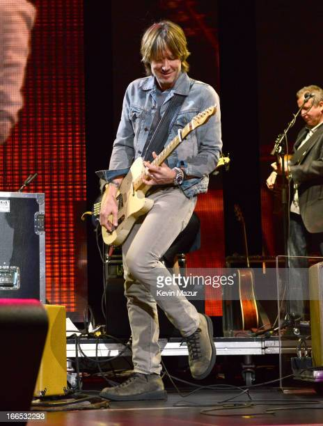 Keith Urban performs on stage during the 2013 Crossroads Guitar Festival at Madison Square Garden on April 13 2013 in New York City