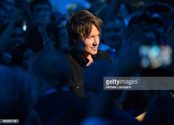 Keith Urban performs onstage at the 2014 CMT Music Awards at Bridgestone Arena on June 4 2014 in Nashville Tennessee
