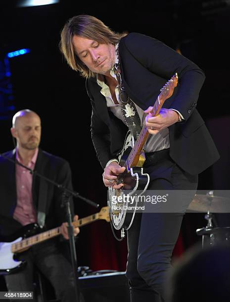 Keith Urban performs onstage at the BMI 2014 Country Awards at BMI on November 4 2014 in Nashville Tennessee