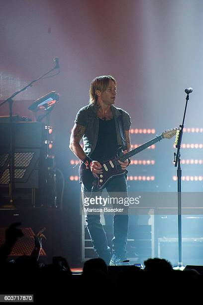 Keith Urban plays the guitar during a performance at Prospera Place on September 11 2016 in Kelowna Canada