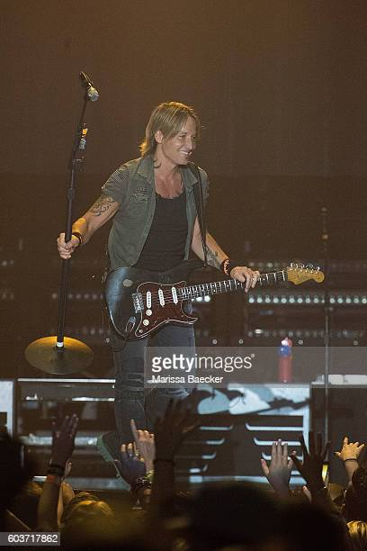 Keith Urban turns his microphone on the audience during a performance at Prospera Place on September 11 2016 in Kelowna Canada