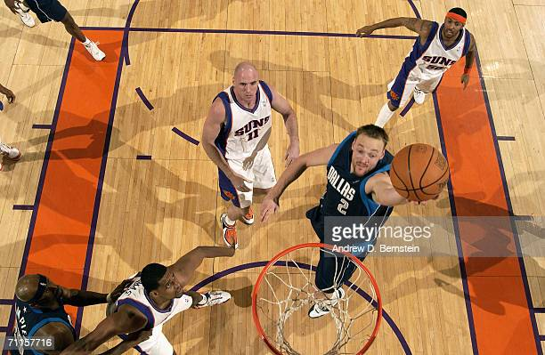 Keith Van Horn of the Dallas Mavericks goes to the basket against Kurt Thomas Pat Burke and Eddie House of the Phoenix Suns in game four of the...