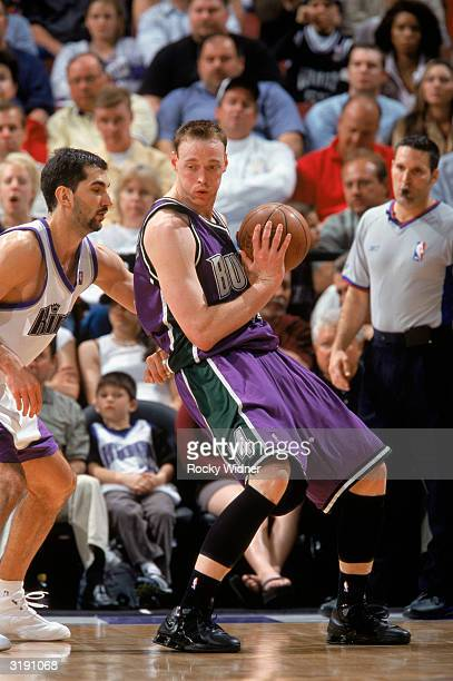 Keith Van Horn of the Milwaukee Bucks guards the ball against Predrag Stojakovic of the Sacramento Kings during the NBA game at Arco Arena on March...