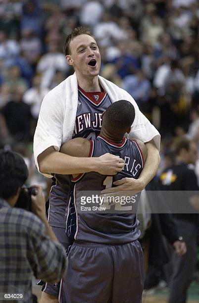 Keith Van Horn of the New Jersey Nets is held up by teammate Lucious Harris after the Nets defeated the Boston Celtics 9688 in Game 6 of the Eastern...