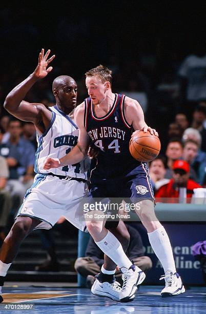 Keith Van Horn of the New Jersey Nets moves the ball against Anthony Mason of the Charlotte Hornets during the game on November 12 1999 at...