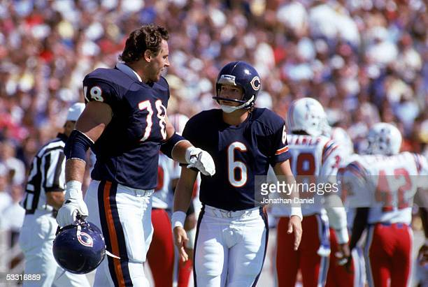 Keith Van Horne and Kevin Butler of the Chicago Bears talk during the game against the New England Patriots at Soldier Field on September 15 1985 in...