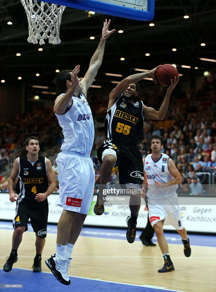 Keith Waleszkowski (L) of Bremerhaven challenges for the ball with Joshua Jackson(R) of Ludwigsburg during the Beko BBL basketball match between Eisbaeren Bremerhaven and Nackar RIESEN Ludwigsburg at the Stadthalle on November 4, 2012 in Bremerhaven, Germany.