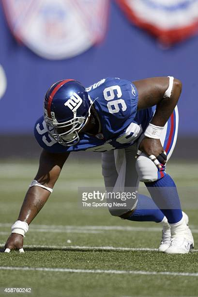 Keith Washington of the New York Giants at the line of scrimmage during a game against the St Louis Rams on September 07 2003 at Giants Stadium in...