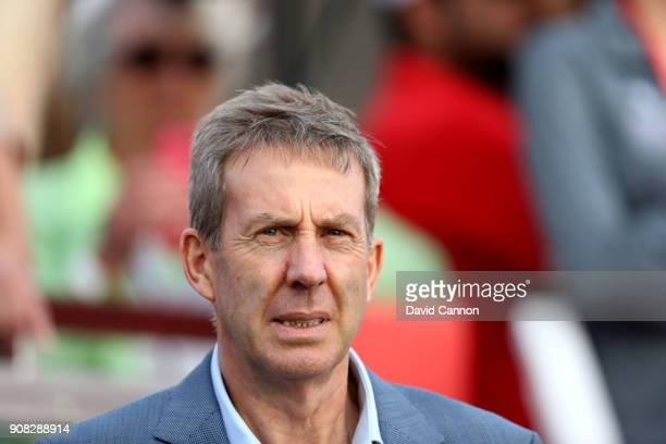 Keith Waters the Chief Operating Officer of the European Tour watches the golf during the final round of the Abu Dhabi HSBC Golf Championship at Abu...